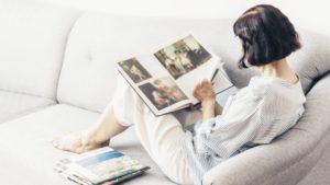 A person looking through photo albums